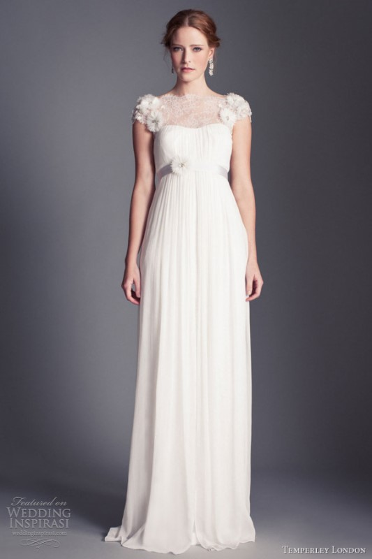 a vintage inspired wedding dress with a lace illusion neckline, applique sleeves, a draped bodice and a pleated skirt