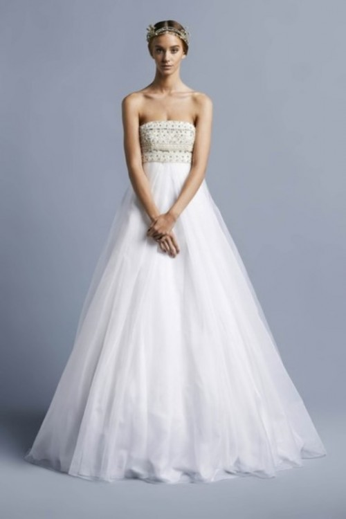 a strapless empire waist wedding ballgown with a lace bodice and a full skirt is boho yet classic at the same time