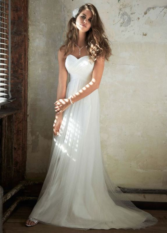 a strapless A line empire waist wedding dress with a draped bodice and pleated skirt with a train is simple and chic