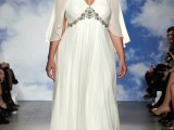 a plus size A-line wedding dress with an embellished bodice, a pleated skirt and a capelet