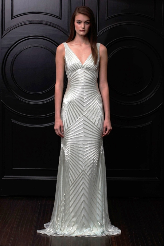 a fitting sleeveless embellished white silk wedding dress with a V neckline for a glam look