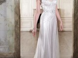 a fitting embellished wedding dress with short sleeves, a deep neckline and a train