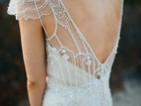 a glam embellished fitting wedding dress with a deep cut back, cap sleeves is ideal for a1920s wedding