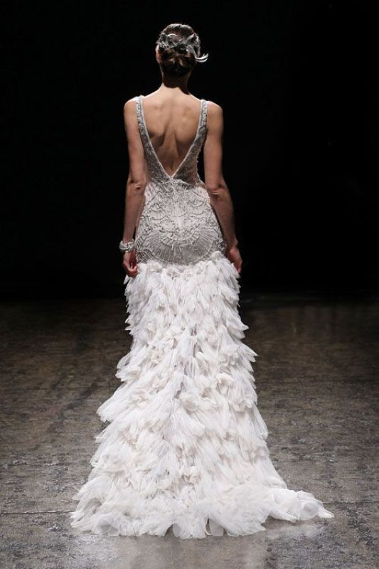 a glam 1920s inspired wedding dress with embellishments, a feather skirt with a train and a cutout back
