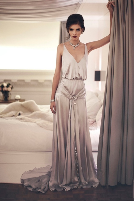 a 1920s inspired silk wedding dress with draperies, embellishments and no sleeves