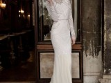 a fitting fully embellished wedding dress with long sleeves, a high neckline, a train and an embellished sash