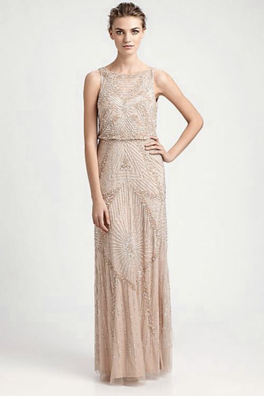 a sleeveless nude fitting fully embellished wedding dress with a high neckline