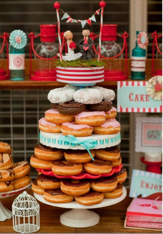 a stand with glazed donuts isn't only a budget friendly but also a trendy idea today   who needs a cake when we can have donuts