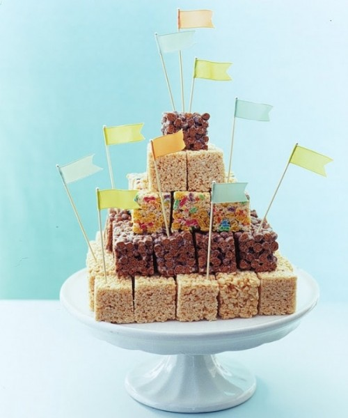 a wedding cake composed of various pieces of krispy rice with colorful toppers looks fun and costs cheap