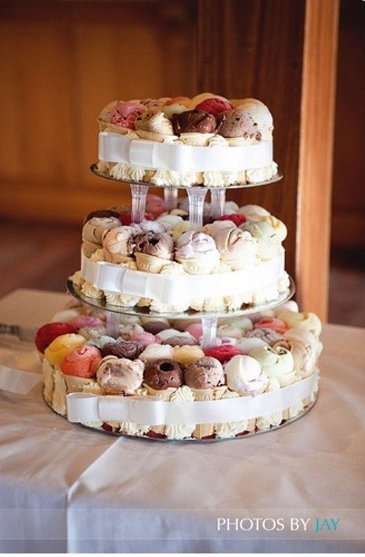 an ice cream cone wedding cake with various kind sof ice cream is a very refreshing idea for a summer wedding