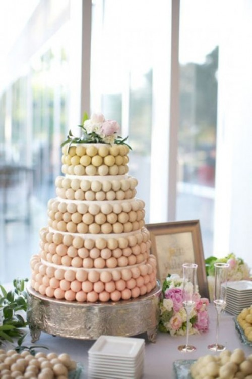 an ombre wedding cake of cake pops is a fresh and unusual alternative to a usual wedding cake