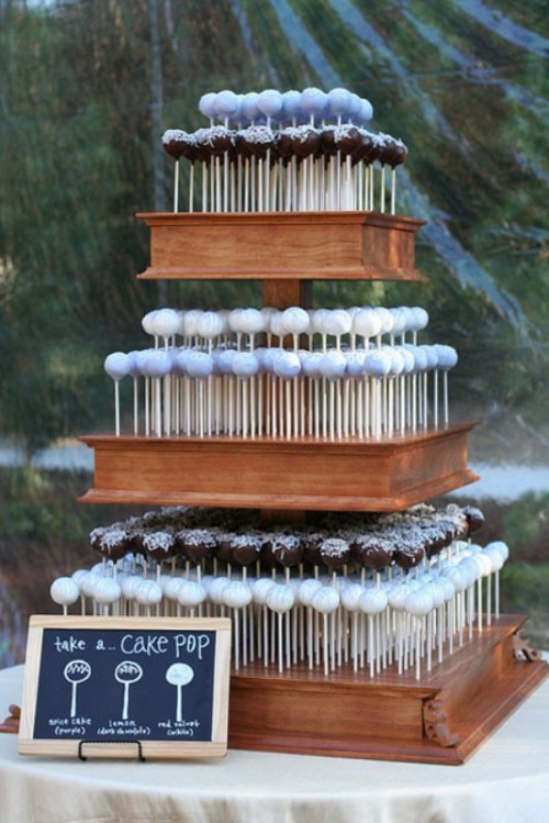 an assortment of cake pops on a stand is a great idea to substitute a usual wedding cake