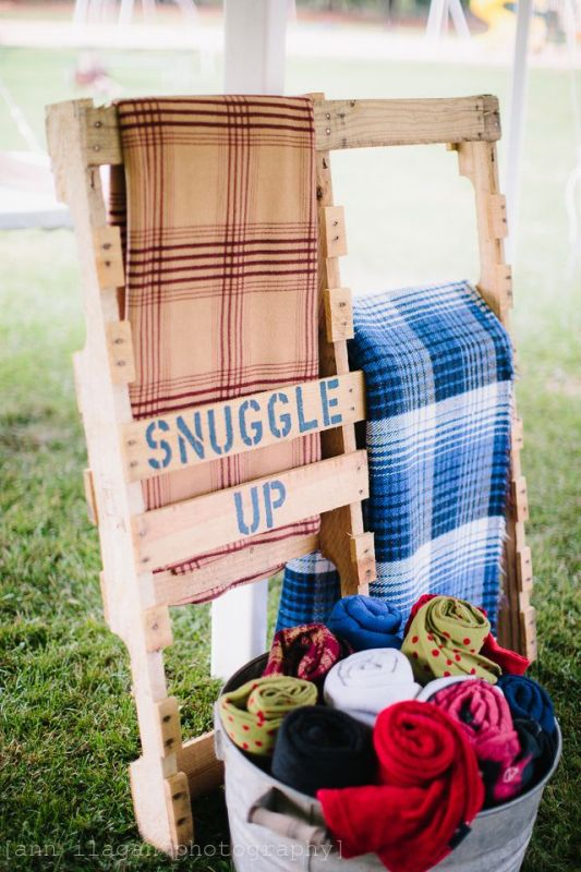a pallet stand for blankets to keep your guests warm and comfortable during a chilly outdoor ceremony or reception