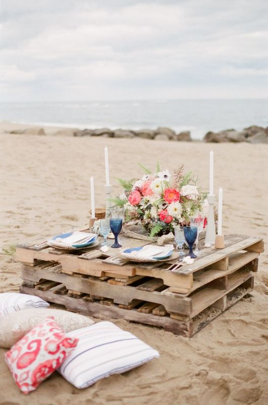 a pallet table may be placed on the beach for your wedding picnic, it's a simple idea