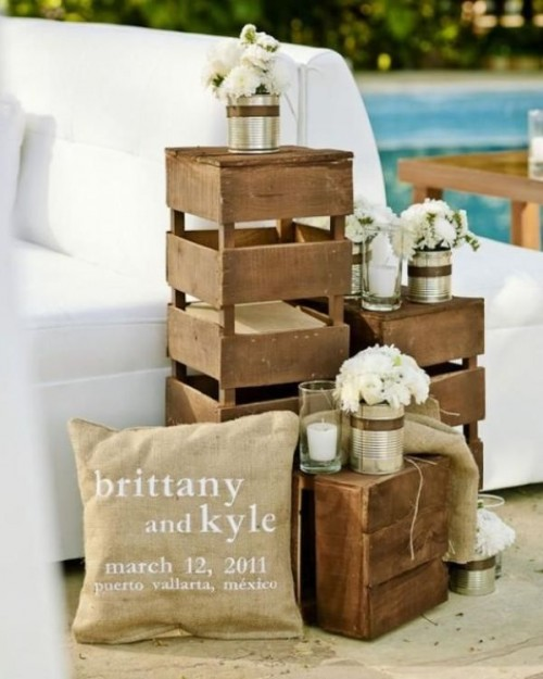 pallet stands with candles and floral arrangements by the furniture are a nice alternative to a side table and you can make them fast and easily