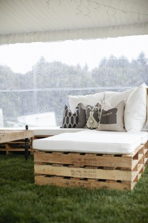 pallet furniture with upholstery and pillows is a budget-friendly and cool idea for your wedding lounge