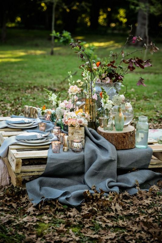 a low table made of pallets can be used for styling a wedding picnic   make it of pallets yourself stacking pallets on each other