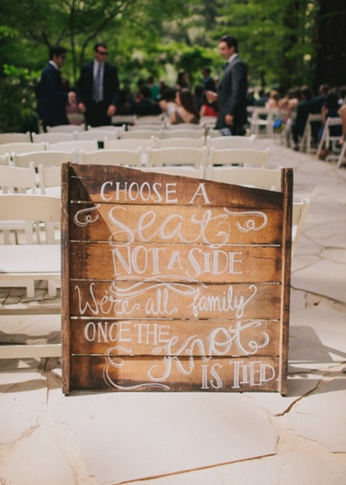 a rustic pallet wedding sign is a nice idea to decorate a wedding ceremony or reception space