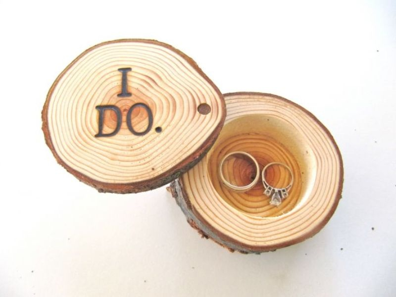 a rustic wedding ring pillow alternative   a box made of tree slices with I Do