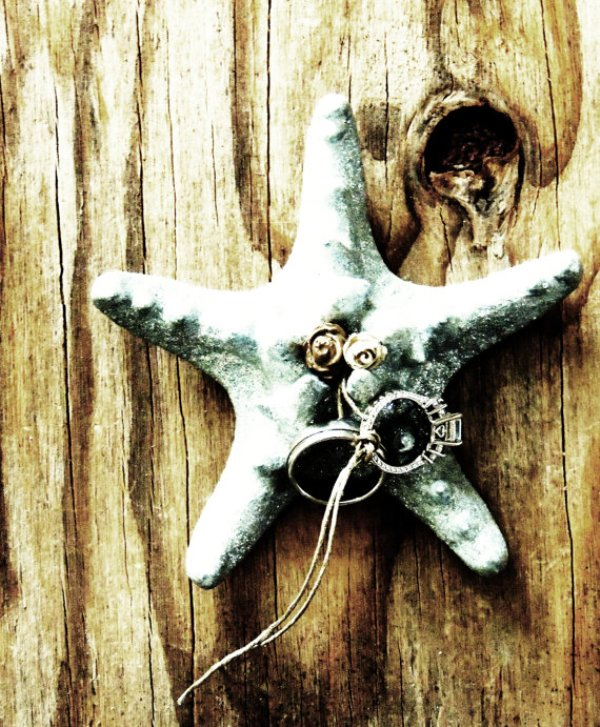 a star fish with ring is a cool idea for a beach or coastal wedding