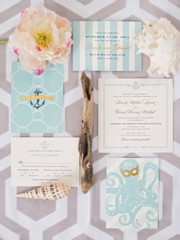 an aqua blue and white wedding invitation suite, with stripes and an octopus is fun and chic