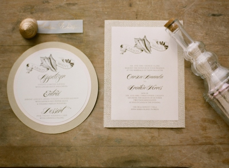 a beautiful ethereal neutral wedding beach invitation suite with seashell prints is very chic and very romantic