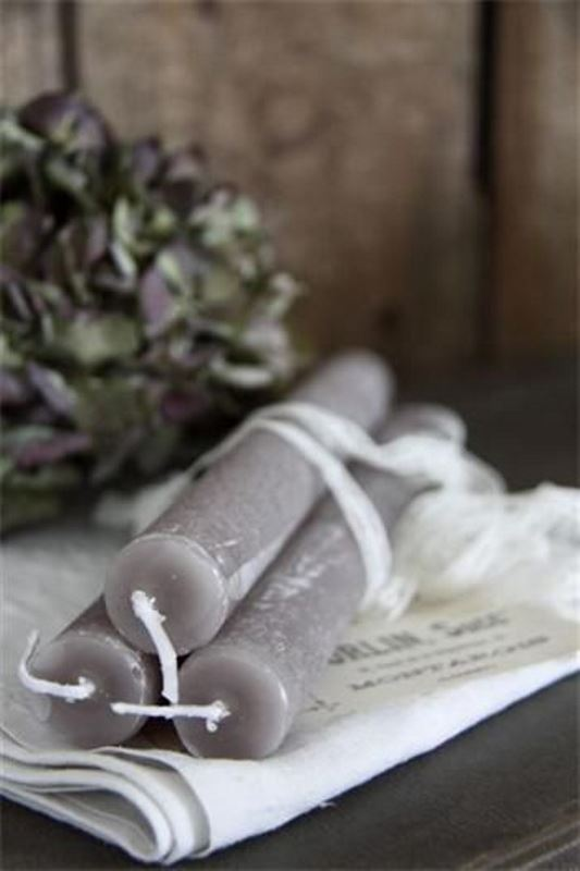 grey candles, tall and thin ones, will be nice for decorating your wedding tablescape