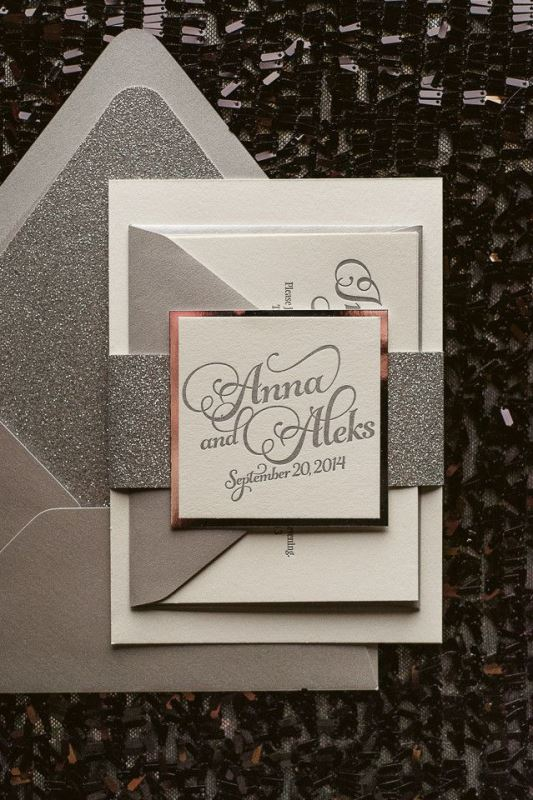 a grey and silver glitter wedding invitation suit with gold framing is a bold glam idea for a winter wedding
