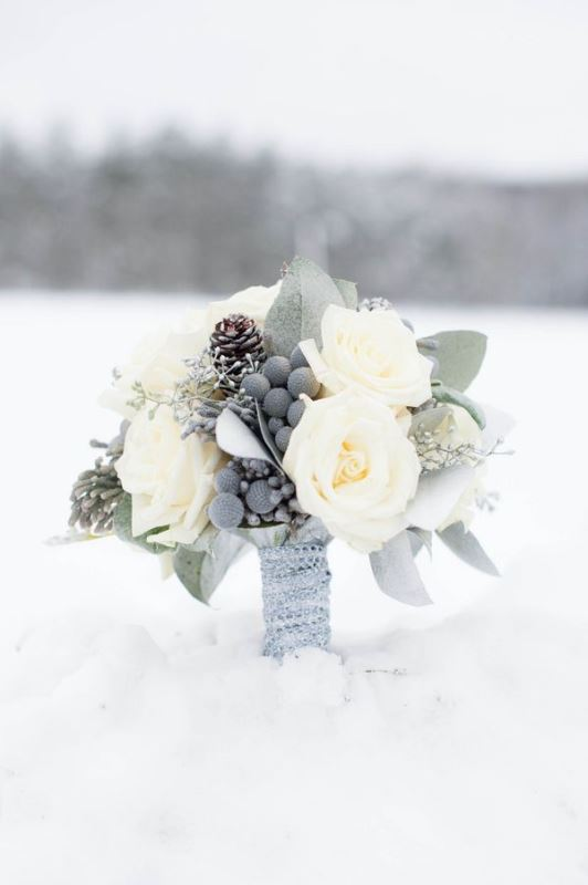 a neutral wedding bouquet with berries, pinecones, white blooms and leaves is a stylish and beautiful idea to rock