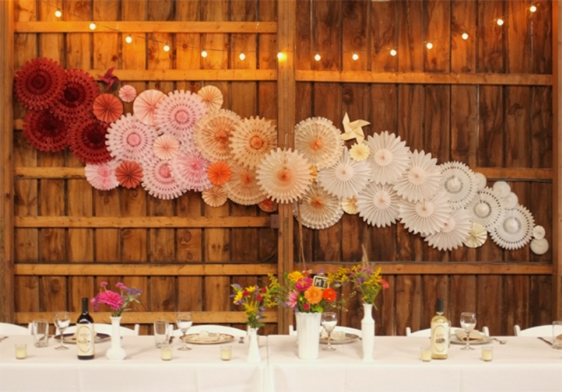 Picture Of Fanciful Ideas Using Pom Poms And Fans In Your Wedding Decor