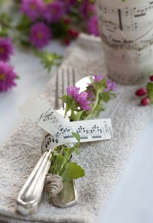 wedding cutlery with blooms secured with note paper is a nice idea for a music-loving wedding