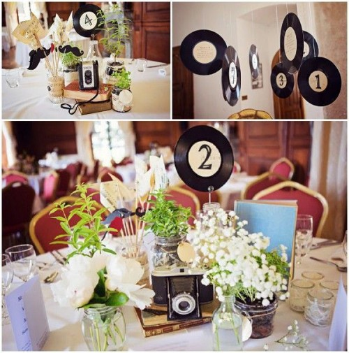 vinyl hanging over the tables and just around the venue and attached to the centerpieces with table numbers