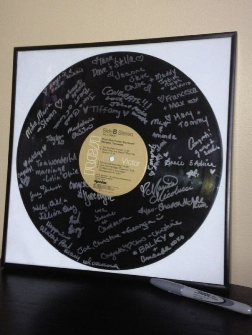 an oversized vinyl with signatures from your guests is a simple and cool guest book