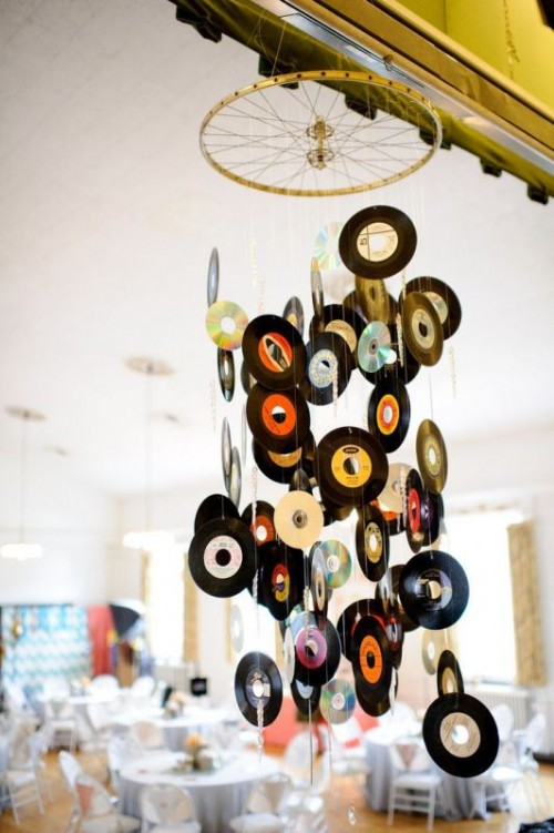 a mobile made of old vinyl is a creative wedding venue decoration for a music-loving wedding