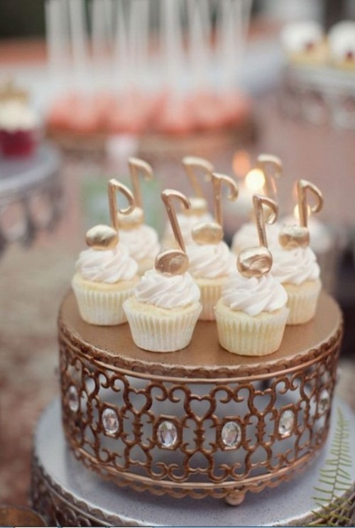 cupcakes topped with large edible gold notes are amazing for a music-loving wedding