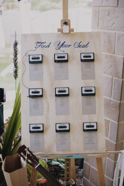 a seating chart done with real tape cassettes is a great and very nostalgic idea for a music-loving wedding