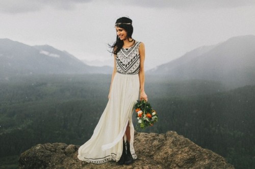 a boho elopement wedding dress with a black embroidered and embellished bodice, a matching headpiece and black boots for hiking