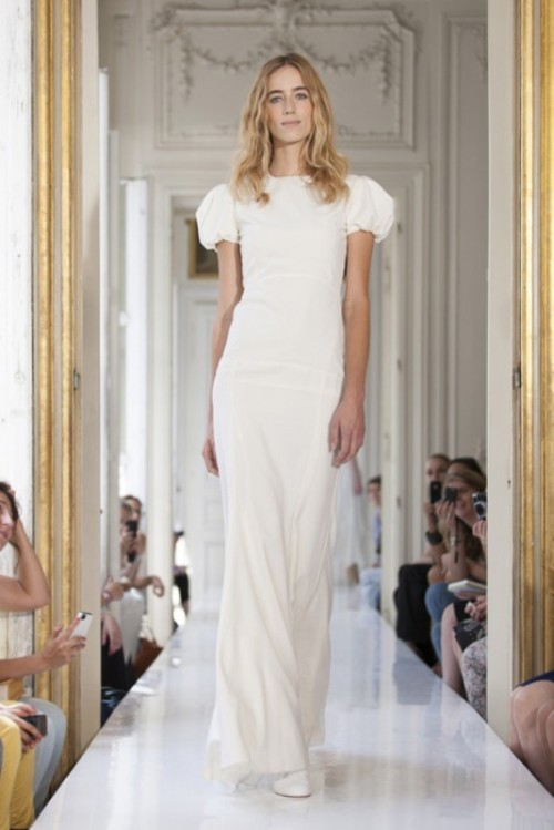 a modern fitting wedding dress with a high neckline and puff sleeves for a romantic elopement