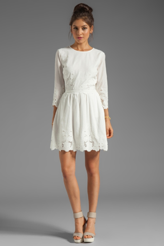 a simple white over the knee dress with a high neckline and short sleeves plus a lace edge is a chic idea