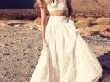 a lace two piece elopement wedding dress with a crop top, short sleeves, a high neckline and A-line skirt for a boho elopement