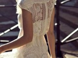 a lace A-line maxi elopement dress with a short plain underdress and a lace cap sleeve overdress