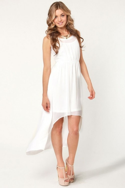 a modern white high low wedding dress with a plain underdress and a sheer pleated high low overdress plus a statement necklace