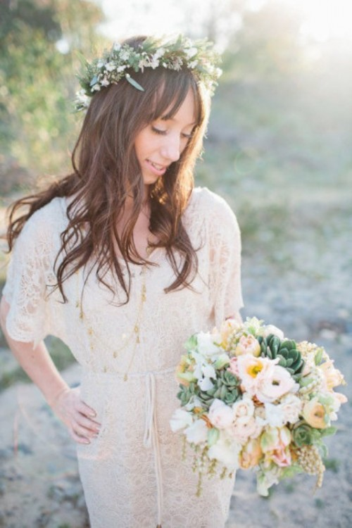 a vintage lace midi wedding dress with short sleeves, layered necklaces and a floral crown