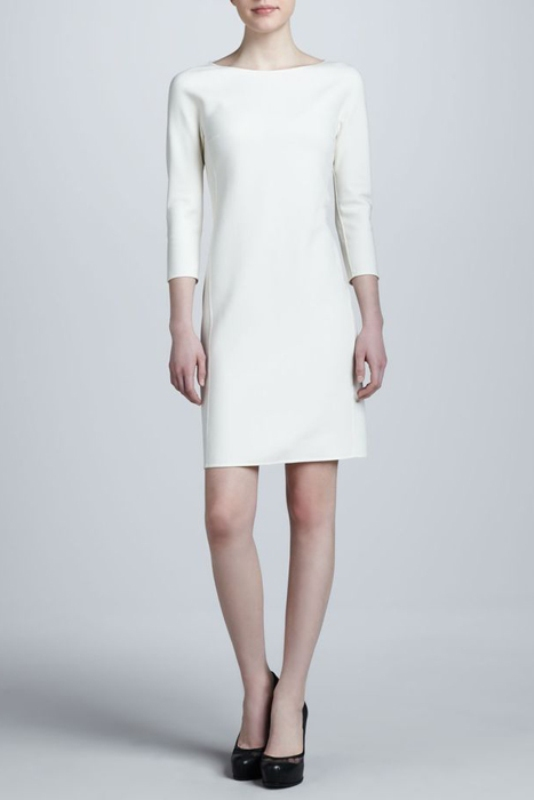 a minimalist mini elopement dress with a high neckline and short sleeve, with bold shoes for a city hall elopement