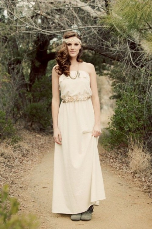 a boho strapless wedding dress wiht a floral sash, grey booties and a lace embellished headband for a vintage elopement