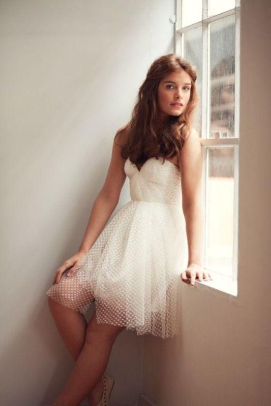 a strapless knee polka dot elopement dress for a modern elopement in the city
