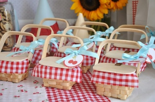 closed boxes with checked fabric and cheeries inside plus cherry tags is ideal for rustic weddings and rehearsal dinners