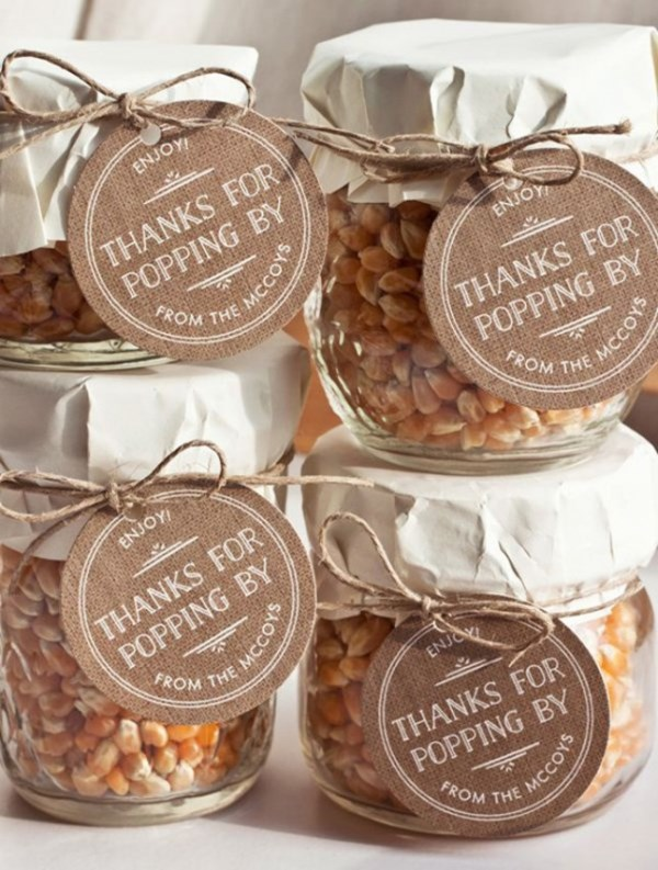 corn in jar with tags for making homemade popcorn is a great favor idea for rehearsal dinners and weddings