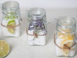 bath salts with various essential oils in jars and slices and herbs attached is a very relaxing kind of favor