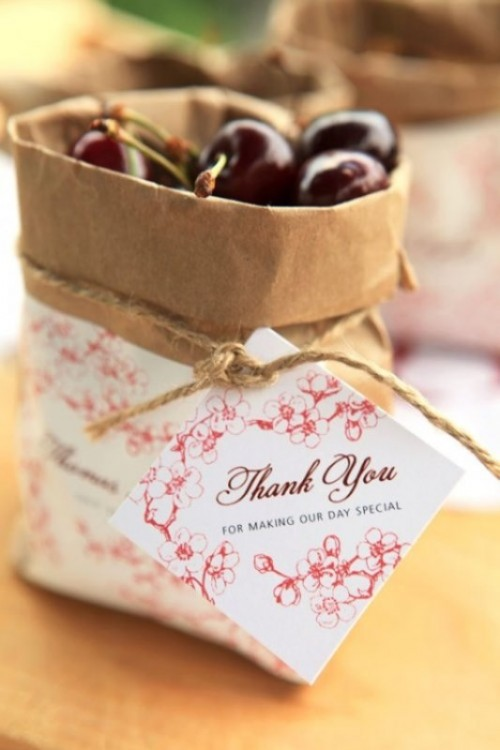 paper bags with personalized tags and fresh cherries are great favors for summer rehearsal dinners or late summer ones